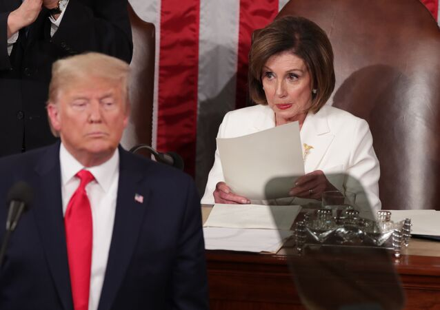 U.S. President Donald Trump speaks near Speaker of the House Nancy Pelosi (D-CA) during his State of the Union address to a joint session of the U.S. Congress in the House Chamber of the U.S. Capitol in Washington, U.S. February 4, 2020