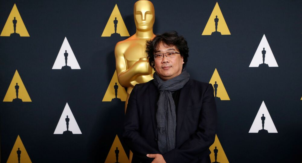 South Korean director Bong Joon-ho, nominated for Best International Feature Film for Parasite, poses at a reception at the Academy of Motion Picture Arts and Sciences in Beverly Hills